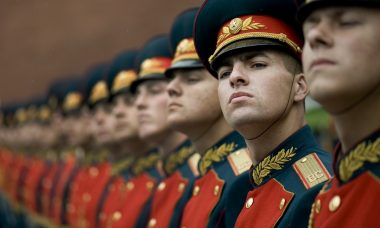 men-in-black-and-red-cade-hats-and-military-uniform-73869