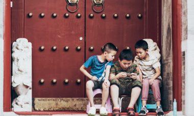 three-boys-sitting-beside-door-2884572-820x550